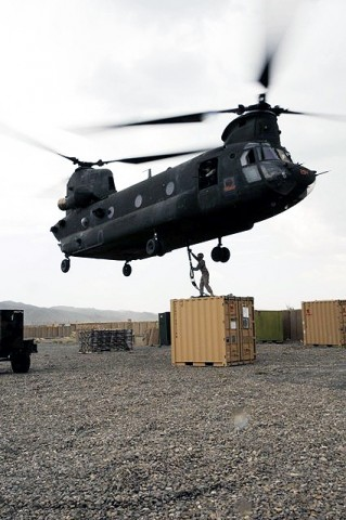 U.S. Army Pvt. Philip C. Brosch, 4th Brigade Combat Team, 101st Airborne Division, braces himself as he prepares to hook up a supply container to a CH-47 Chinook helicopter at Forward Operating Base Orgun-E Sept. 10th.(Photo by U.S. Army Spc. Luther L. Boothe Jr., Task Force Currahee Public Affairs, 4th Brigade Combat Team, 101st Airborne Division)