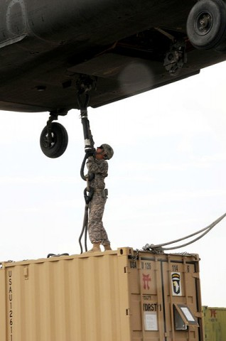 U.S. Army Pvt. Philip C. Brosch, 4th Brigade Combat Team, 101st Airborne Division, hooks up a supply container to a CH-47 Chinook helicopter at Forward Operating Base Orgun-E Sept. 10th. (Photo by U.S. Army Spc. Luther L. Boothe Jr., Task Force Currahee Public Affairs, 4th Brigade Combat Team, 101st Airborne Division)