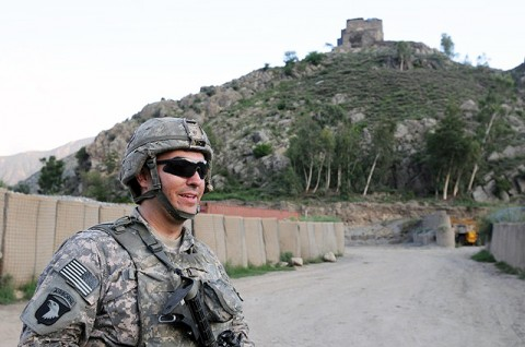 U.S. Army Spc. Brian O. Mieszala of Lockport, IL, a grenadier with Company A, 2nd Battalion, 327th Infantry Regiment, Task Force No Slack, stands on Combat Outpost Monti in eastern Afghanistan's Kunar Province. In the background is Observation Post Coleman, a historical fort that provides over watch for the base. (Photo by U.S. Army Staff Sgt. Gary A. Witte, 300th Mobile Public Affairs Detachment)