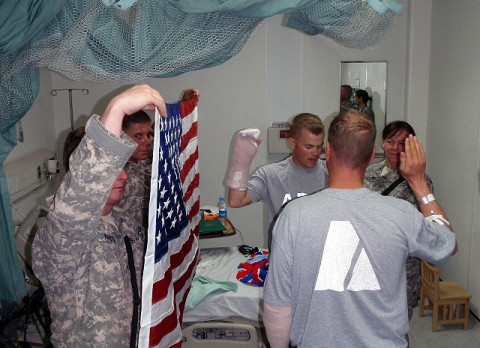 U.S. Army 2nd Lt. Brady Juelson from Palm Coast, FL, administered the reenlistment oath as Bickers held up his right hand. Juelson was also wounded in the engagement and did his best to administer the oath with his bandaged hands. (U.S. Army photo by 1st Lt. R.J. Peek)