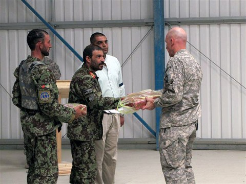 U.S. Army Lt. Col. David Fivecoat, and Afghan National Army Commander Zamaray exchange gifts of gratitude for their partnership over the past six months in Paktika Province. On Sept. 10th, Task Force Iron Rakkasan, 3rd Battalion, 187th Infantry, 3rd Brigade from the 101st Airborne Division, conducted the official transfer of authority ceremony for western Paktika Province to Task Force Red Currahee, 1st Battalion, 506th Infantry, 4th Brigade from the 101st Abn. Div. (Photo by U.S. Army 1st Lt. R.J. Peek, 3rd Battalion, 187th Infantry, 101st Airborne Division)