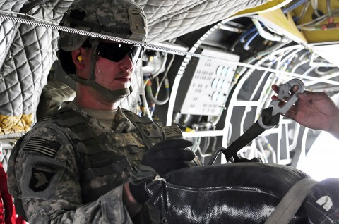 """The jumpmaster waits for the Chinook pilots to give the order to """"execute"""" the airdrop before pushing the bundle out the back of the aircraft"""