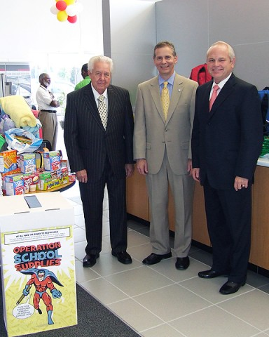 "Mr. Gary Mathews and Mr O.B. Garland, Owner partners of Mathews Nissan, flank State Representative Joe Pitts as they survey the items donated for the Teacher's Warehouse during Mathews Nissan's ""Operation School Supplies""."