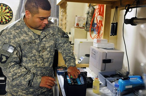 U.S. Army Pvt. Joseph D. Villanueva, of Houston, Texas, a preventive medicine technician with Company C, 426th Brigade Support Battalion, Task Force Bastogne, prepares to test water samples for harmful chemicals at Forward Operating Base Fenty Aug. 31st. (Photo by U.S. Army Spc. Albert Kelley, 300th Mobile Public Affairs Detachment)