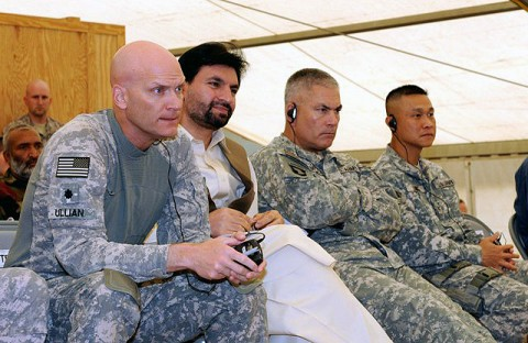 U.S. Army Lt. Col. Richard Ullian (left), commanding officer, 3rd Battalion, 320th Field Artillery Regiment; Naeemi, governor of Khowst Province; U.S. Army Maj. Gen. John Campbell, commanding general, 101st Airborne Division; and U.S. Army Col. Viet Luong, commanding officer, 3rd Brigade, 101st Airborne Division, from Fort Campbell, KY, listen in at a recent Election Combined Arms Rehearsal meeting Sept. 15th at Forward Operating Base Salerno. (Photo by U.S. Army Sgt. Brent C. Powell, 3rd Brigade, 101st Airborne Division)