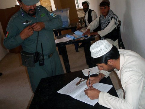 Deh Yak's police chief, Haji Faiz Mohammad Tufan, prepares to cast his vote Sept. 18th at the Ramak Mosque polling center. Task Force Iron Rakkasan assisted the Afghan government and the Afghan National Security Forces in eastern Ghazni Province to provide for safe and legitimate polling. (Photo by U.S. Army 1st Lt. R.J. Peek, 3rd Battalion, 187th Infantry, 101st Airborne Division)