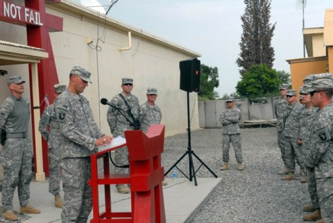 """U.S. Army Chaplain (Maj.) Tom Faichney, from Toronto, 3rd Brigade Combat Team, leads a group of Soldiers in prayer during a memorial service remembering the 9/11 attacks exactly nine years later Sept. 11th. """"As we reflect here this afternoon, we realize that the events of nine years ago continue to have repercussions on this very day,"""" Faichney said. (Photo by U.S. Army Pfc. Chris McKenna, 3rd Brigade Combat Team)"""