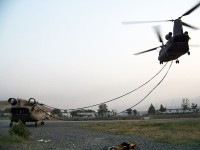 Camp Blackhorse, Afghanistan – A U.S. Army Chinook helicopter from Company B, Task Force Knighthawk, 3rd Combat Aviation Brigade, TF Falcon, hooks up to a sling a damaged Chinook July 27th on Camp Blackhorse. (Photo by U.S. Army Maj. Heather Weigner, Task Force Workhorse, 3rd Combat Aviation Brigade, TF Falcon)