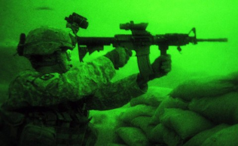 Brass shells fly as U.S. Army Sgt. Joseph P. Khamvongsa of Mililani, Hawaii, a forward observer with 1st Platoon, Company B, 2nd Battalion, 327th Infantry Regiment, Task Force No Slack, returns fire against an Aug. 25th insurgent attack on Combat Outpost Badel. The enemy attacked at dusk with small arms and rocket-propelled grenades against the base in eastern Afghanistan's Kunar province. Neither International Security Assistance Forces nor Afghan National Security Forces were injured during the assault. (Photo by U.S. Army Staff Sgt. Gary A. Witte, 300th Mobile Public Affairs Detachment)