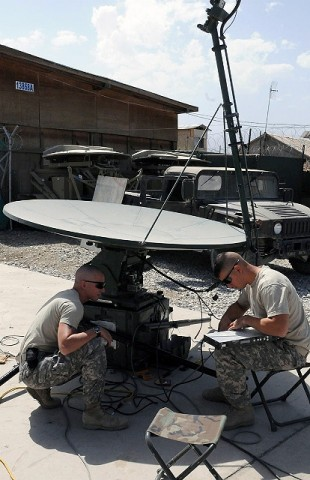 U.S. Army Sgt. Matthew S. Grey (left), and U.S. Army Sgt. William M. Hemingway, both TT/SPOP trainers and reset technicians with Company C, Headquarters and Headquarters Battalion, 101st Airborne Division, troubleshoot a problem with an SIPR point of presence system here Sept. 7. (Photo by U.S. Army Sgt. Grant Matthes, Regional Command-East Public Affairs)