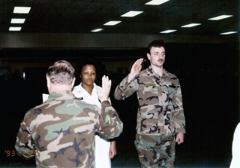 U.S. Army Spc. Michael D. Mullan reenlists in the Army at a ceremony in 1993. Mullan, who was an Army reservist, later climbed the ranks to captain. He was killed while working as a New York Firefighter when terrorists attacked the World Trade Center Sept. 11, 2001. Soldiers of his reserve unit, the 344th Combat Support Hospital, recently remembered him during a 9/11 remembrance ceremony at Forward Operating Base Salerno.  (Official U.S. Army Photo)