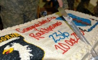 "A Soldier from Task Force Rakkasan cuts the t cake at the ""10-10-10"" re-enlistment ceremony at Forward Operating Base Salerno, Khowst Province, Afghanistan Oct. 10th. The Rakkasans reenlisted 236 Soldiers, one to mark each year the U.S. Army has been in existence. (U.S. Army Photo by Maj. S. Justin Platt, 3rd Brigade Combat Team Public Affairs)"
