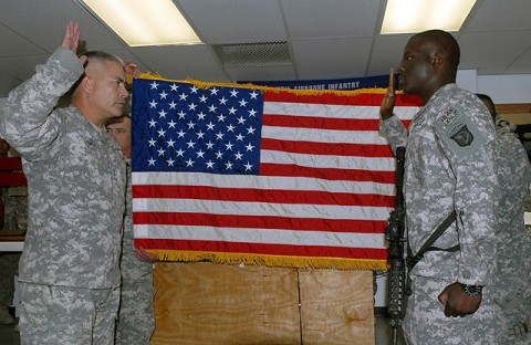 U.S. Army Maj. Gen. John Campbell, 101st Airborne Division commander, re-enlists U.S. Army Spc. Anthony Oniyelu, Headquarters and Headquarters Company, 3rd Brigade Combat Team, 101st Airborne Division, from Miami, during a mass re-enlistment ceremony consisting of 236 Rakkasan Soldiers Oct. 10th. (U.S. Army Photo by Pfc. Chris McKenna, 3rd Brigade Combat Team Public Affairs)