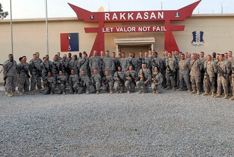 U.S. Army Maj. Gen. John Campbell, 101st Airborne Division commander, and U.S. Army Col. Viet Luong, Task Force Rakkasan commander, stand with the 77 Soldiers who re-enlisted at Forward Operating Base Salerno Oct. 10th. A total of 236 Soldiers re-enlisted, with the rest doing so via video teleconference from 13 remote locations in TF Rakkasan's Area of Operations. (U.S. Army Photo by Pfc. Chris McKenna, 3rd Brigade Combat Team Public Affairs)