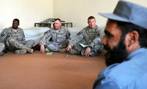 From left, U.S. Army Capt. Thomas Whitfield of Kingstree, SC, U.S. Army Lt. Col. David J. Goetze of Roseau, MN, and U.S. Army Capt. Robert R. Reynolds of Huntsville, Ala., meet with Afghan police officers and the Watapur District sub-governor here Sept. 25th. Goetze commands the Kunar Security Forces Assistance Team, Task Force Bastogne. Officials discussed local law enforcement and how International Security Forces could help. (Photo by U.S. Army Staff Sgt. Gary A. Witte, 300th Mobile Public Affairs Detachment)