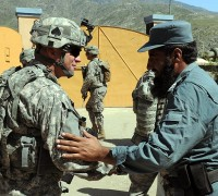 U.S. Army Sgt. 1st Class James E. Tembrock of Elizabethtown, KY, shakes hands with an Afghan police officer during a Sept. 25th visit at the Watapur District Center in eastern Afghanistan's Kunar Province. Tembrock is the noncommissioned officer in charge of the Kunar Security Forces Assistance Team, Task Force Bastogne. (Photo by U.S. Army Staff Sgt. Gary A. Witte, 300th Mobile Public Affairs Detachment)