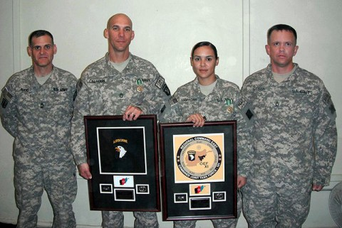 U.S. Army Sgt. 1st Class Matthew Calhoun (center left) of Visalia, CA, 2nd Brigade Combat Team, Task Force Strike, was selected as the 101st Airborne Div. Career Counselor of the Year; and U.S. Army Staff Sgt. Yelixa Mawhorr (center right) of Brooklyn, NY, 3rd Combat Aviation Brigade, Task Force Falcon, was selected as the RC-East Career Counselor of the Year here Oct. 14th. (Photo courtesy of the U.S. Army)