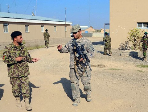U.S. Army Sgt. Pedro Rodriguez-Ortiz, a native of Los Angeles, CA, and a squad leader for 1st Squad, 1st Platoon, Company C, 1st Squadron, 33rd Cavalry, discusses squad movement techniques with his Afghan counterpart Staff Sgt. Zaratgul Tofan, an Afghan National Army squad leader and native of Kabul Province, during patrol training at Camp Parsa Oct. 4th. (Photo by U.S. Army Staff Sgt. Brent C. Powell, 3rd Brigade, 101st Airborne Division)