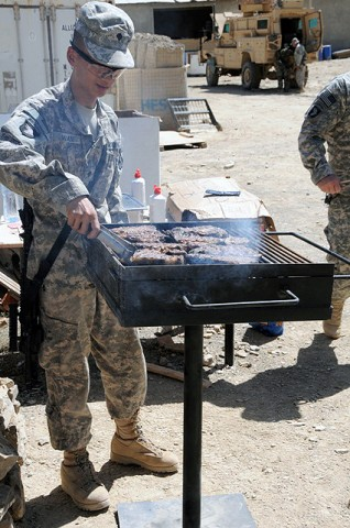 U.S. Army Spc. Jian Guo Wang, a food service specialist with Headquarters Company, 801st Brigade Support Battalion, 4th Brigade Combat Team, 101st Airborne Division and native of Brooklyn, NY, grills steaks for Task Force Currahee Soldiers, deployed to Combat Outpost Munoz Sept 26th.  (Photo by U.S. Army Spc. Luther L. Boothe Jr., Task Force Currahee Public Affairs Office)