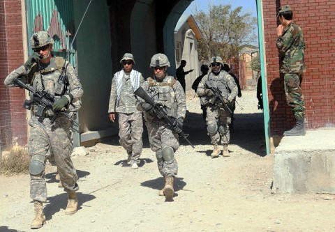 Task Force Currahee Soldiers from Company C, 1st Battalion of the 506th Infantry Regiment, 4th Brigade Combat Team, 101st Airborne Division, leave Forward Operating Base Khayr-Khot Castle on a joint patrol with the Afghan National Army to the city of KKC Oct. 6th. (Photo by U.S. Army Spc. Luther L. Boothe Jr., Task Force Currahee Public Affairs, 4th Brigade Combat Team, 101st Airborne Division)