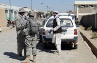 U.S. Army Sgt. David Jansky, squad leader and company counterinsurgency team member of 3rd Squad, 3rd Platoon, Company C, 1st Battalion of the 506th Infantry Regiment, 4th Brigade Combat Team, 101st Airborne Division, and a Towner, N.D. native, talks with a resident of the city of Khayr-Khot Castle while Afghan National Army soldiers search his vehicle Oct. 6th. (Photo by U.S. Army Spc. Luther L. Boothe Jr., Task Force Currahee Public Affairs, 4th Brigade Combat Team, 101st Airborne Division)
