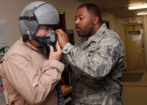 U.S. Army Maj. Gen. John F. Campbell, Combined Joint Task Force 101, Regional Command East commander, is assisted by Air Force Tech. Sgt. Marlon D. White, 336th Expeditionary Fighter Squadron aircrew flight equipment technician from Centenary, SC, with the fitting of a flight helmet Oct. 20th for an upcoming flight on an F-15E Strike Eagle. (Photo by U.S. Air Force Tech. Sgt. M. Erick Reynolds, Regional Command East Public Affairs)