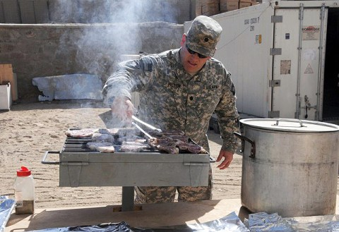 As part of the Steak and Ice Cream Express mission to boost morale for Soldiers at remote bases, U.S. Army Lt. Col. David Preston, commander of the 801st Brigade Support Battalion, 4th Brigade Combat Team, 101st Airborne Division, grills steaks Oct. 20th. (Photo by U.S. Army Spc. Christina Sinders, Task Force Currahee Public Affairs)