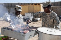 As part of the Steak and Ice Cream Express mission to boost morale for Soldiers at remote bases, U.S. Army Chief Warrant Officer Amanda Milstead and U.S. Army Pvt. Chyanne Easter, food specialists with the 801st Brigade Support Battalion, 4th Brigade Combat Team, 101st Airborne Division, grill steaks Oct. 20th, (Photo by U.S. Army Spc. Christina Sinders, Task Force Currahee Public Affairs)