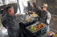 As part of the Steak and Ice Cream Express mission to boost morale for Soldiers at remote bases, U.S. Army Lt. Col. David Preston, commander of the 801st Brigade Support Battalion, 4th Brigade Combat Team, 101st Airborne Division, serves steak, coleslaw, potato salad and ice cream Oct. 20th. (Photo by U.S. Army Spc. Christina Sinders, Task Force Currahee Public Affairs)