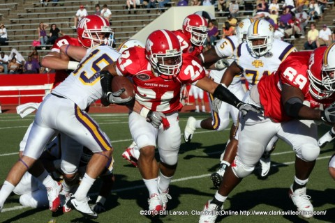 Running back Ryan White moving the ball upfield against a stiff Tennessee Tech Defense