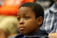 A young man listens to Erin Gruwell talk to the college students