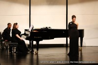 Joy Schreier playing the piano during the performance
