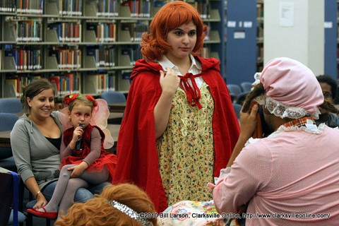 Little Red Riding hood talking to Harry Wolf