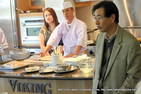 Hiroshi Sato, the Counsul-General of the Japan Embassy in Nashville addresses the crowd at the Viking Store in Frankin, TN; as Chef Masahiko Yanagihara looks on