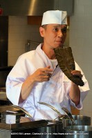 Chef Yanagihara hold up a piece of kombu seaweed