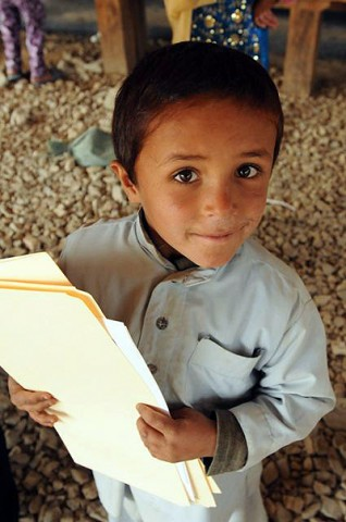 An Afghan child participates in a new literacy program at the Egyptian Field Hospital here Oct. 28th. (Photo by U.S. Army Staff Sgt. Whitney Hughes, Task Force Wolverine Public Affairs, 86th Infantry Brigade Combat Team (Mountain))
