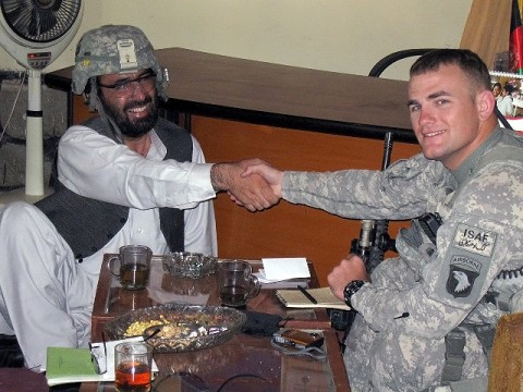 U.S. Army 2nd Lt. Brian Rowan, a member of Support Platoon, Headquarters and Headquarters Company, 1st Special Troops Battalion, Task Force Spartan, and native of Langhorne, PA, shares a laugh with the District Development Assembly Chief Malik Niamat in the Behsood District here Oct. 4th. Rowan talked with Niamat about what projects will be discussed at the next DDA meeting. (Photo by U.S. Army Staff Sgt. William Smith, Task Force Spartan)