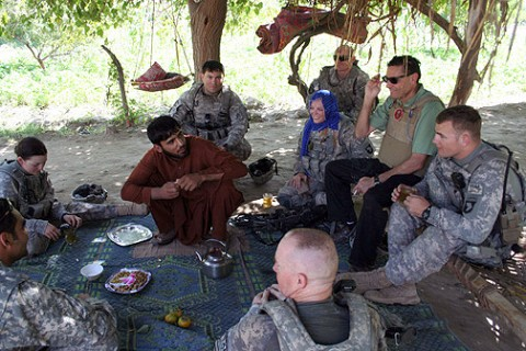Members of Support Platoon, Headquarters and Headquarters Company, 1st Special Troops Battalion, Task Force Spartan, meet with a local village leader to discuss the needs of his people Oct. 4th. (Photo by U.S. Army Staff Sgt. William Smith,  Task Force Spartan)