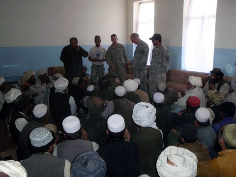 Task Force Iron Rakkasan leadership speaks to village elders and the Andar district sub-governor Oct. 8th following an incident that resulted in civilian casualties. The insurgent-initiated firefight resulted in four civilians killed and three civilians wounded. The wounded were evacuated to nearby Forward Operating Base Ghazni for medical care and eventually taken to Bagram Air Field. (Photo by U.S. Army Capt. Scott Harris)