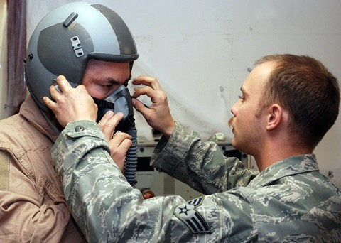U.S. Air Force Senior Airman KevCombined Joint Task Force 101, Regional Command East commander, with final adjustments to his flight helmet here Oct. 21st before going on a familiarization flight in an F-15E Strike Eagle. (Photo by U.S. Air Force Tech. Sgt. M. Erick Reynolds, Regional Command East Public Affairs)