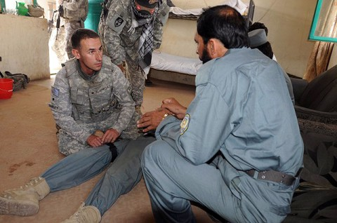 U.S. Army Spc. Jared Shiflet, a combat medic and native of Tampa, FL, assigned to the 330th Military Police Company, demonstrates to an Afghan National Policeman how to apply a tourniquet at the Mandowzai District Center Oct. 7th. Shiftlet and the other Soldiers of his unit are helping to train and advise nearly 300 ANP. (Photo by U.S. Army Staff Sgt. Brent C. Powell, 3rd Brigade, 101st Airborne Division)