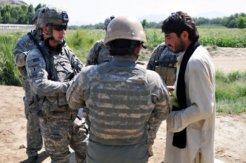 U.S. Army 1st Lt. Dan J. Konopa, of Kokomo, Ind., a platoon leader with 1st Platoon, Company D, 2nd Battalion, 327th Infantry Regiment, Task Force Spartan, talks with a local farmer in the Goshta District in eastern Afghanistan's Nangarhar Province Sept. 26th. Konopa's platoon gave the farmer a large bag of rice as compensation for his crops that were partially damaged by a military all-terrain vehicle earlier in the month. (Photo by U.S. Army Sgt. Albert L. Kelley, 300th Mobile Public Affairs Detachment)
