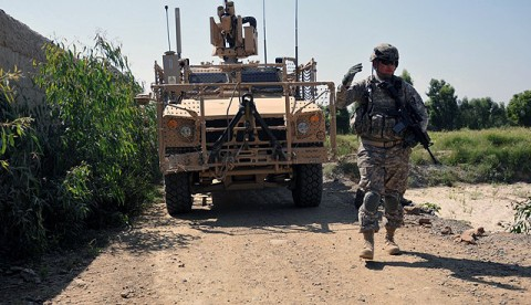 U.S. Army Sgt. 1st Class Derek L. Ashman, of San Diego, a platoon sergeant with 1st Platoon, Company D, 2nd Battalion, 327th Infantry Regiment, Task Force Spartan, guides an mine resistant ambush protected all-terrain vehicle along a narrow road Sept. 26th. Ashman's platoon was visiting a local farmer whose crops had been partially damaged earlier in the month by a military vehicle. (Photo by U.S. Army Sgt. Albert L. Kelley, 300th Mobile Public Affairs Detachment)