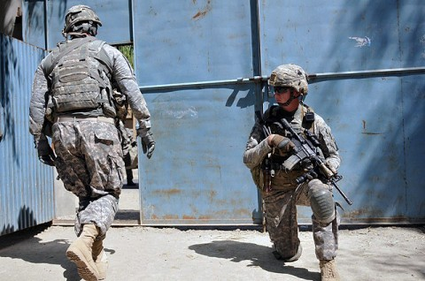 U.S. Army Sgt. Christopher L. Dixon, of San Antonio, a section sergeant with 1st Platoon, Company D, 2nd Battalion, 327th Infantry Regiment, Task Force Spartan, provides security while Soldiers from his unit prepare to board their vehicles, Sept. 26th. His unit visited a school in the Goshta District in eastern Afghanistan's Nangarhar Province to donate school supplies and recreational items. (Photo by U.S. Army Sgt. Albert L. Kelley, 300th Mobile Public Affairs Detachment)