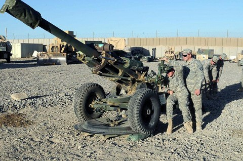 U.S. Army Spc. Adam C. Haas, a cannon crewmember with Battery A, 4th Battalion, 320th Field Artillery Regiment, 4th Brigade Combat Team, 101st Airborne Division and native of Ionia, MI, sites in the M119 howitzer Oct. 6th while being inspected by U.S. Army Sgt. James D. Storozuk, a native of Clarksville, TN, on Forward Operating Base Khayr-Khot Castle. The cannon crew uses their down time to cross-train all crew members on every position on the gun. (Photo by U.S. Army Spc. Luther L. Boothe Jr., Task Force Currahee Public Affairs)
