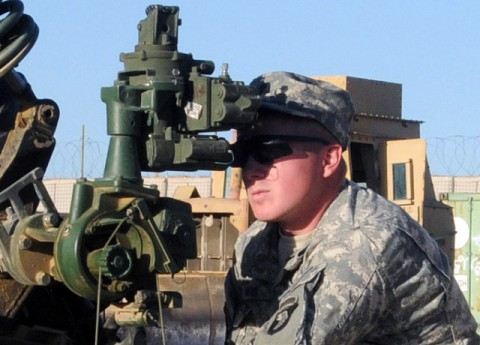 U.S. Army Spc. Adam C. Haas, a cannon crewmember with Battery A, 4th Battalion, 320th Field Artillery Regiment, 4th Brigade Combat Team, 101st Airborne Division, and native of Ionia, MI, sites in the M119 Howitzer Oct. 6th while cross training at Forward Operating Base Khayr-Khot Castle here. The cannon crew uses their down time to cross train all the Soldiers on every position on the gun. (Photo by U.S. Army Spc. Luther L. Boothe Jr., Task Force Currahee Public Affairs)