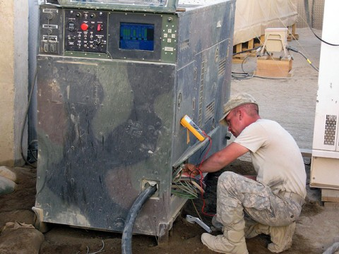 U.S. Army Spc. Steven Carter, works on one of the generators to maintain stable power flow through Forward Operating Base Andar. The original establishment of the FOB provided small generators for each primary building. The reorganized power system allows the FOB to operate using generators. (Photo by U.S. Army 1st Lt. R.J. Peek, 3rd Battalion, 187th Infantry, 101st Airborne Division)
