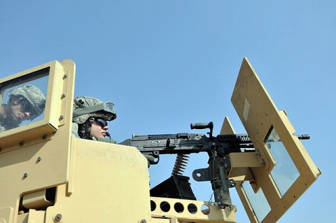 U.S. Army Pfc. Rodney C. Wall of Hutchinson, KS, a fire support specialist with Fire Support Element, Headquarters and Headquarters Company, Task Force Bastogne, fires an M240B machine gun at a heavy weapons range in eastern Afghanistan's Nangarhar Province Oct. 11th. (Photo by U.S. Army Spc. Richard Daniels Jr., Task Force Bastogne Public Affairs)