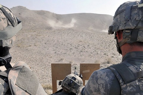 (Right) U.S. Army Sgt. Kevin M. Monroe of Salt Lake City, Utah, a Combat Observation Lasing Team member from the Fire Support Element, Headquarters and Headquarters Company, Task Force Bastogne, observes as U.S. Army 1st Lt. Jonathan M. Downes of Granville, Ohio, platoon leader with Transportation Platoon, Company A, 426th Brigade Support Battalion, fires an M240B machine gun at a heavy weapons range in eastern Afghanistan's Nangarhar Province Oct. 11th. (Photo by U.S. Army Spc. Richard Daniels Jr., Task Force Bastogne Public Affairs)