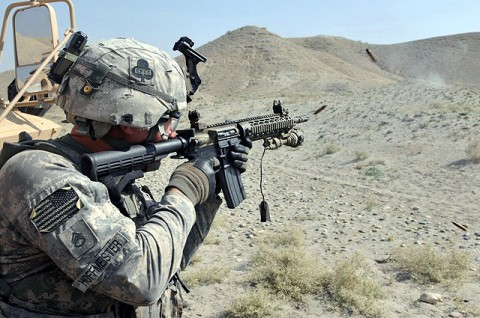 U.S. Army Staff Sgt. Jobe D. Hoffmeisterin of Clarksville, TN, Transportation Platoon, Company A, 426th Brigade Support Battalion, fires a fully automatic M4 rifle at a heavy weapons range in eastern Afghanistan's Nangarhar Province Oct. 11th. Task Force Taskmaster Soldiers understand weapons familiarization and proficiency could make the difference in the fiercest of battles. (Photo by U.S. Army Spc. Richard Daniels Jr., Task Force Bastogne Public Affairs)